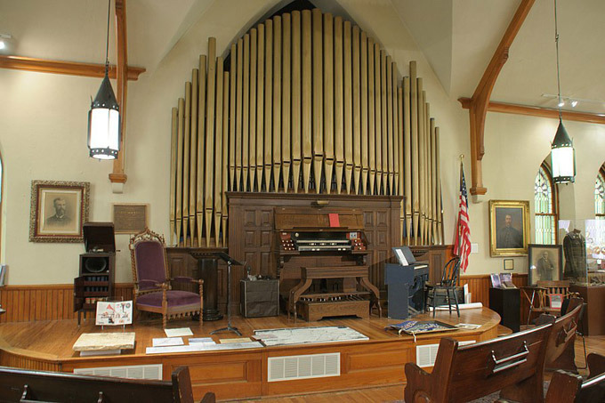 "This 1885 organ built by the A.B. Felgemacher Organ  Company of Erie, PA is housed in the Society's Museum.  Formerly the First Presbyterian Church of Ellicott City, this magnificent building features stained and leaded glass windows as well as a ""hidden"" rose window picturing two angels depicting Henry and Melissa, children of Rev. Branch, who died in infancy.  The building was donated by Mrs. Alda Hopkins Clark in 1958 and is now used to display our Museum collection as well as a venue for organ concerts, meetings and weddings."